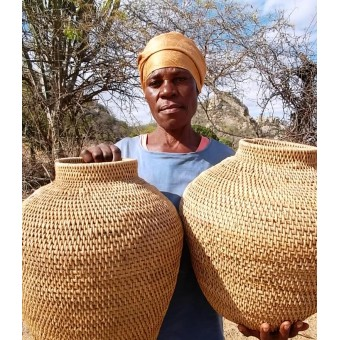 The Weaver of the Giant Grain storage baskets.