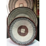 Tonga Flat Wall Decorative Baskets - Handcrafted by women`s group in Binga Zimbabwe comes in different shades,,shapes and sizes